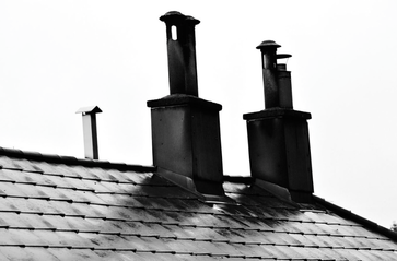 Chimneys don't clean themselves and this is a picture showing dirty chimneys in Omaha Nebraska.