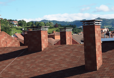 Picture of a row of chimneys that were professionally inspected in Omaha Nebraska.